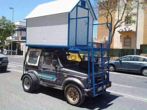 Suzuki Samurai Jeep Spotted with a Rooftop Tiny House or Shed
